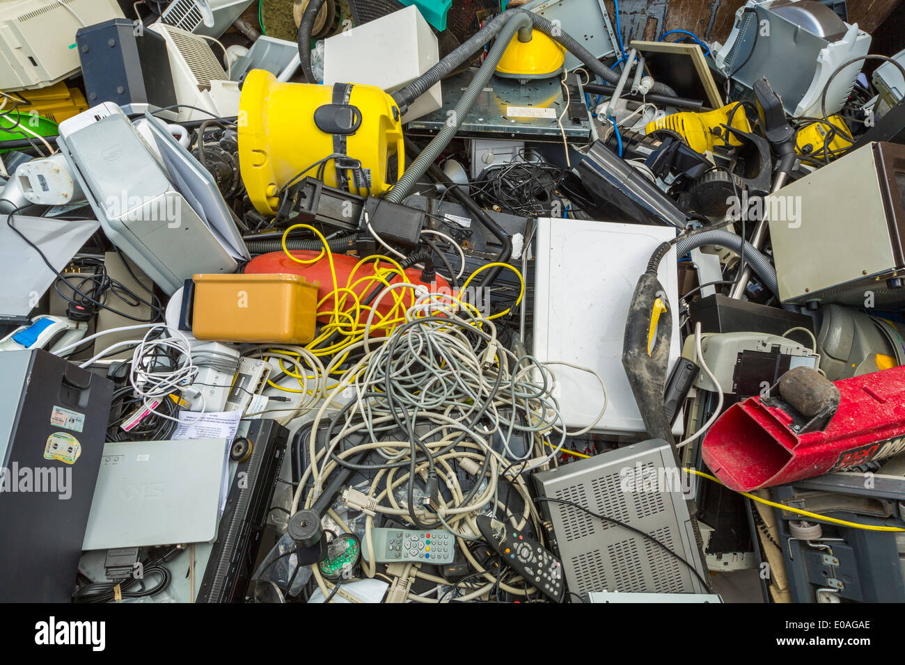 Small electrical appliances laying in a recycling container, London, UK Stock Photo