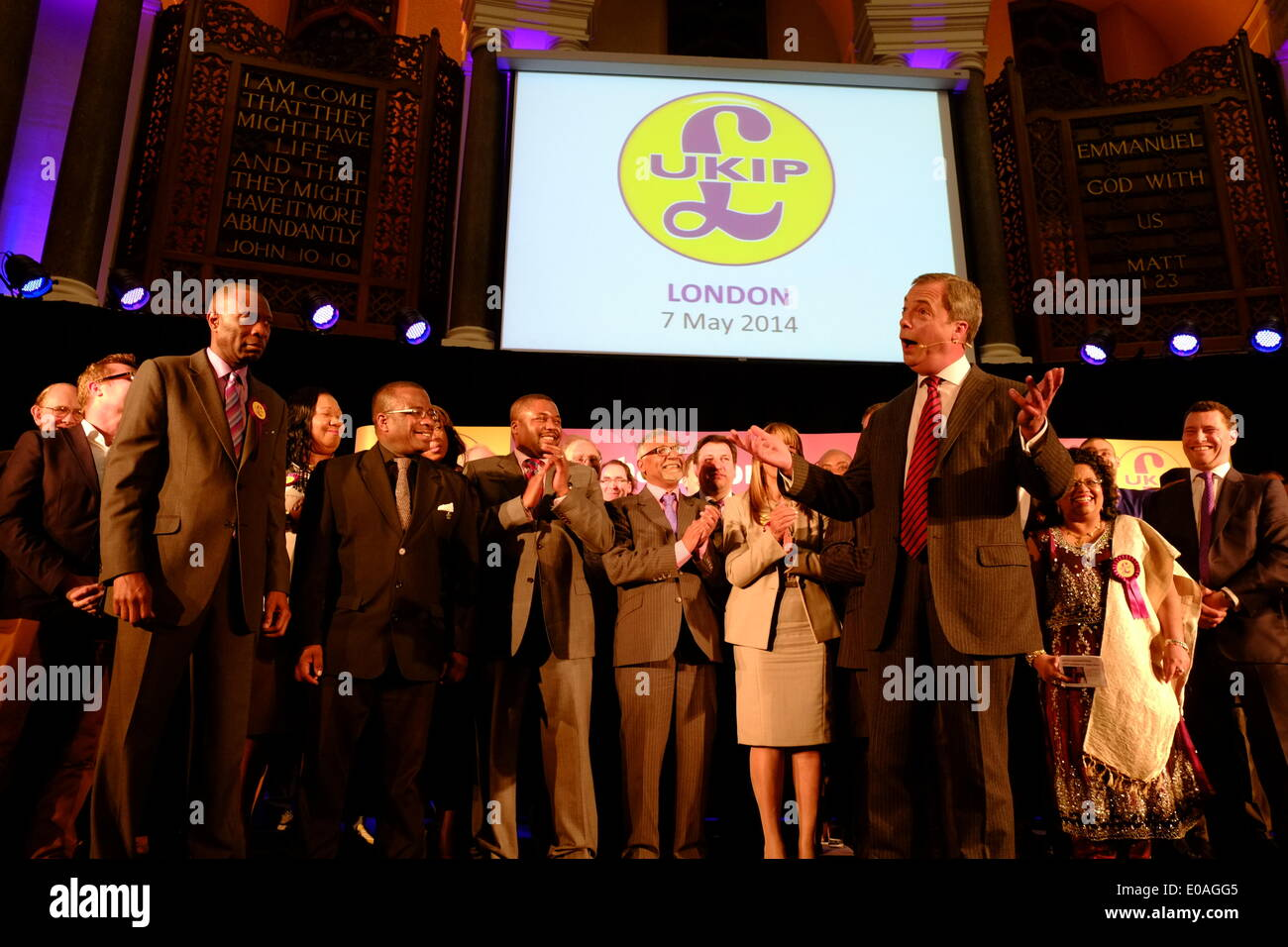 London, UK. 7th May 2014. Nigel Farage speaks at the final venue on the 'UKIP People's Army' tour on astage filled with party candidates Credit:  Rachel Megawhat/Alamy Live News - Stock Image