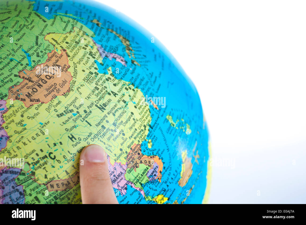 Finger pointing China on the global map - Stock Image