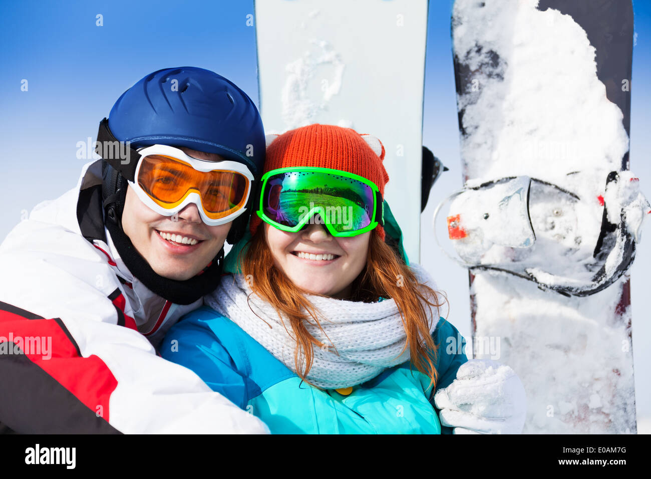 Man and woman in ski mask smiling Stock Photo