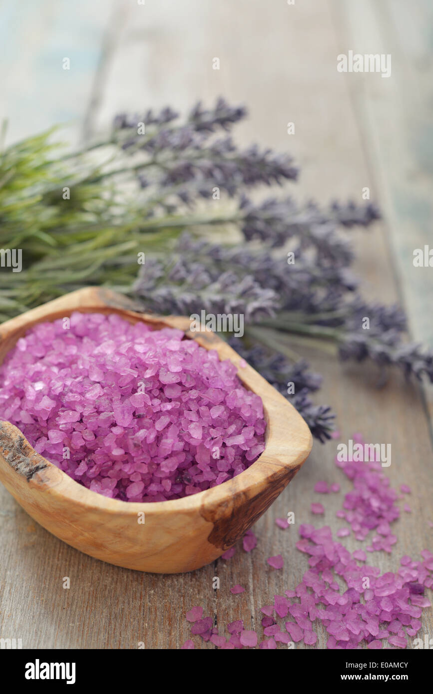 Bouquet lavender with sea salt on wooden background closeup Stock Photo
