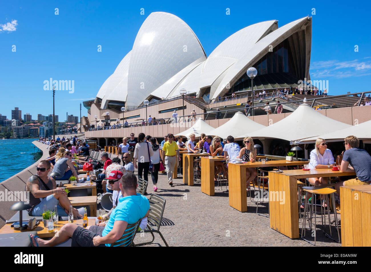 Sydney Australia NSW New South Wales Sydney Harbour harbor East Circular Quay Sydney Opera House promenade Opera Bar restaurant alfresco dining tables - Stock Image