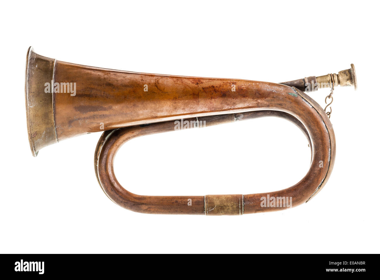an old and rusty bugle isolated over a white background - Stock Image