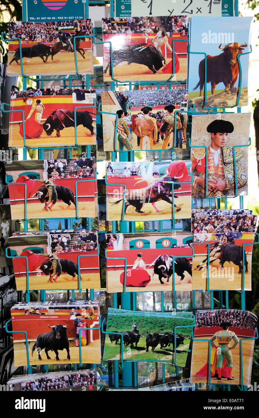 Bullfighting postcards in a rack, Malaga, Costa del Sol, Malaga Province, Andalucia, Spain, Western Europe. Stock Photo