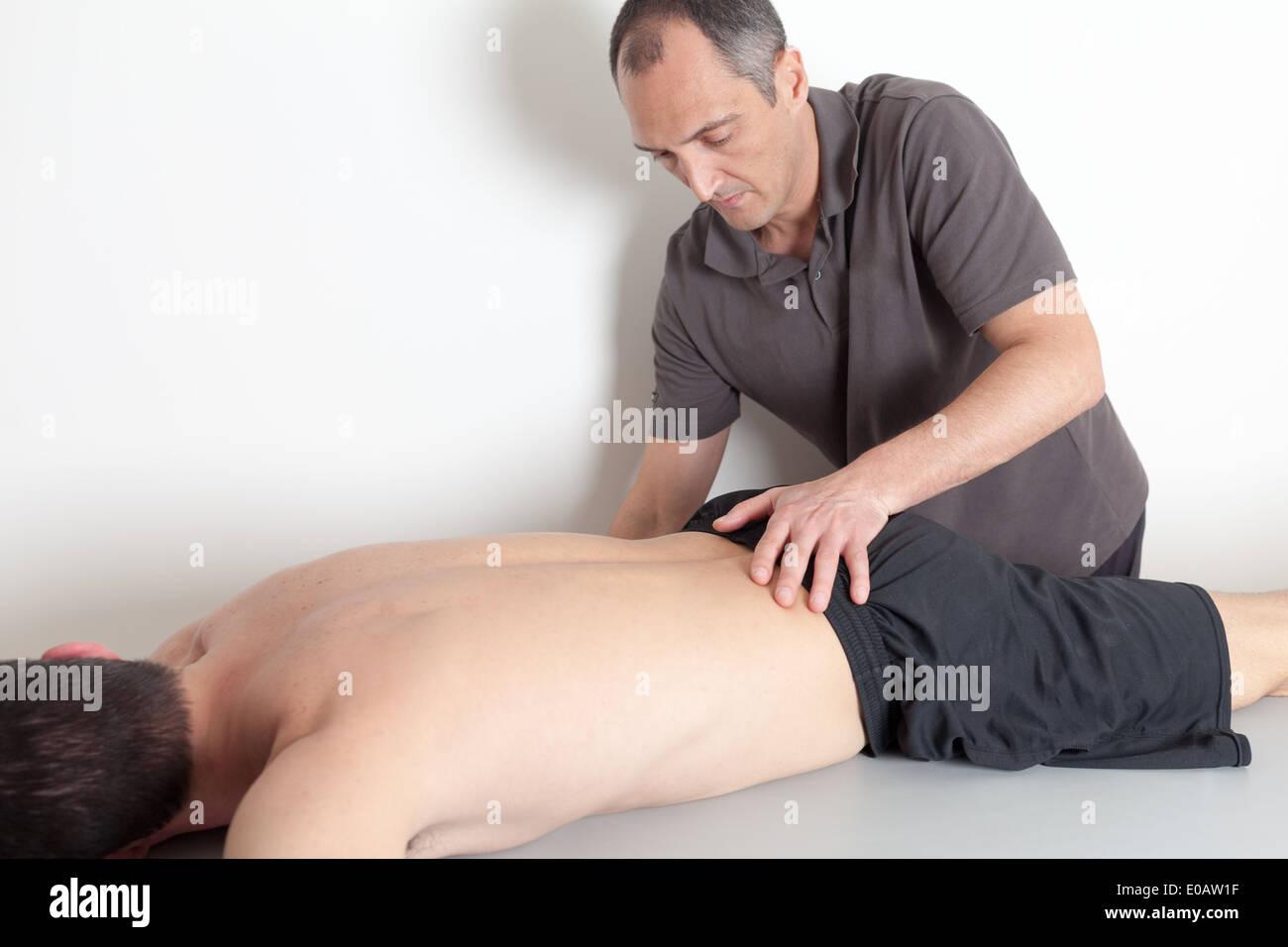 pelvis manipulation - Stock Image