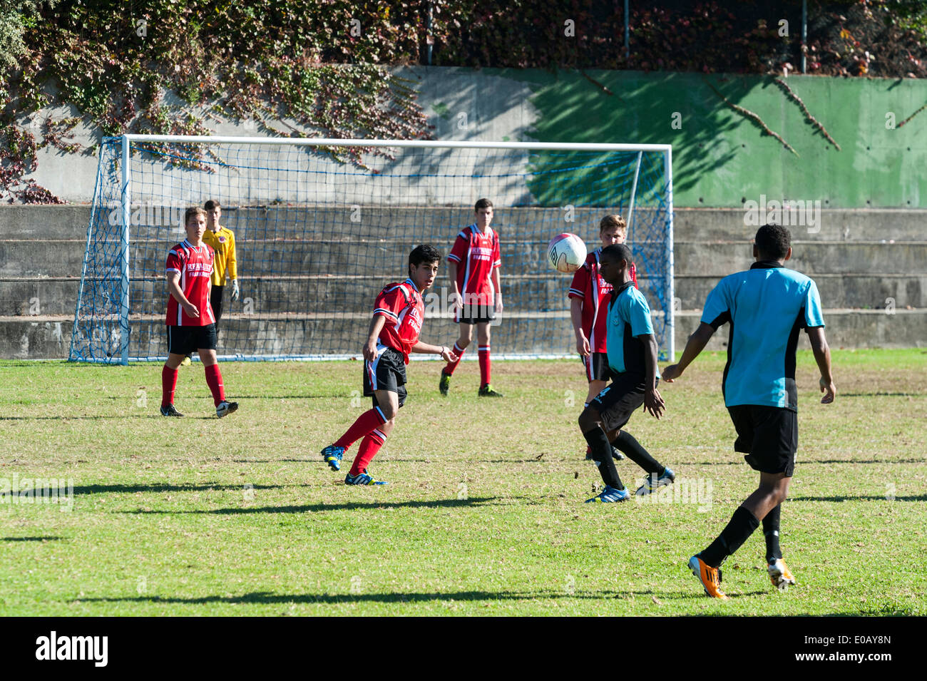 Youth football team paying a match, referee watching, Cape Town, South Africa - Stock Image