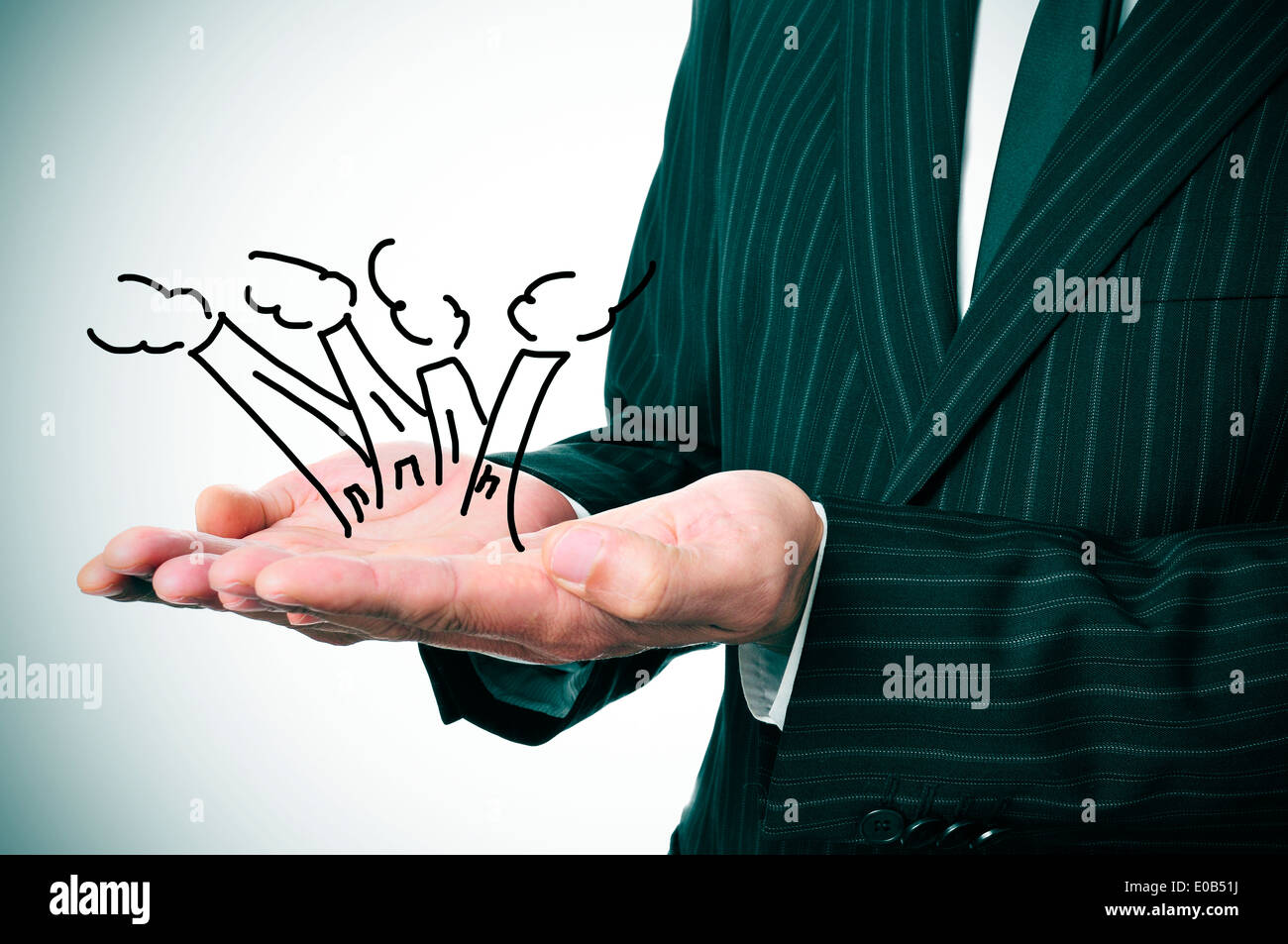 a businessman with a drawing of some industrial chimneys in his hands - Stock Image