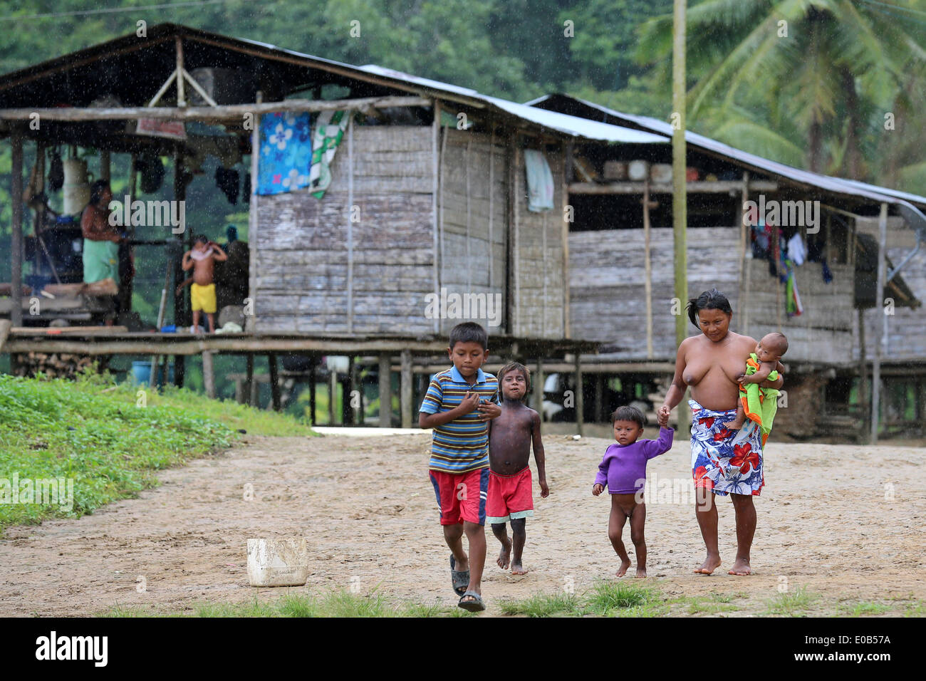 indigenous tribes people and wooden houses on stilts in the jungle village Puerto Alegre Nauca,  Choco province,  Colombia - Stock Image