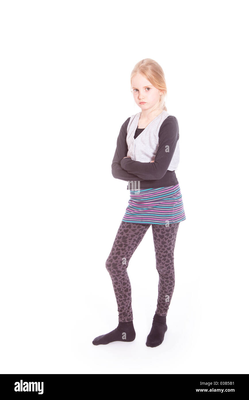young blond girl with angry attitude in studio against white background - Stock Image