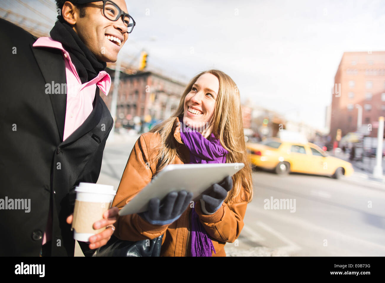 Young couple using digital tablet in New York, USA Stock Photo
