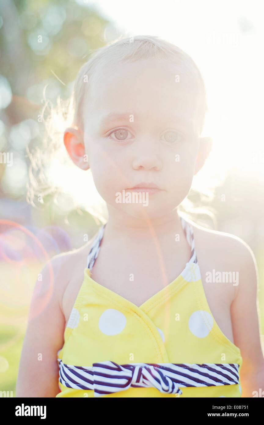 Close up portrait of backlit female toddler - Stock Image