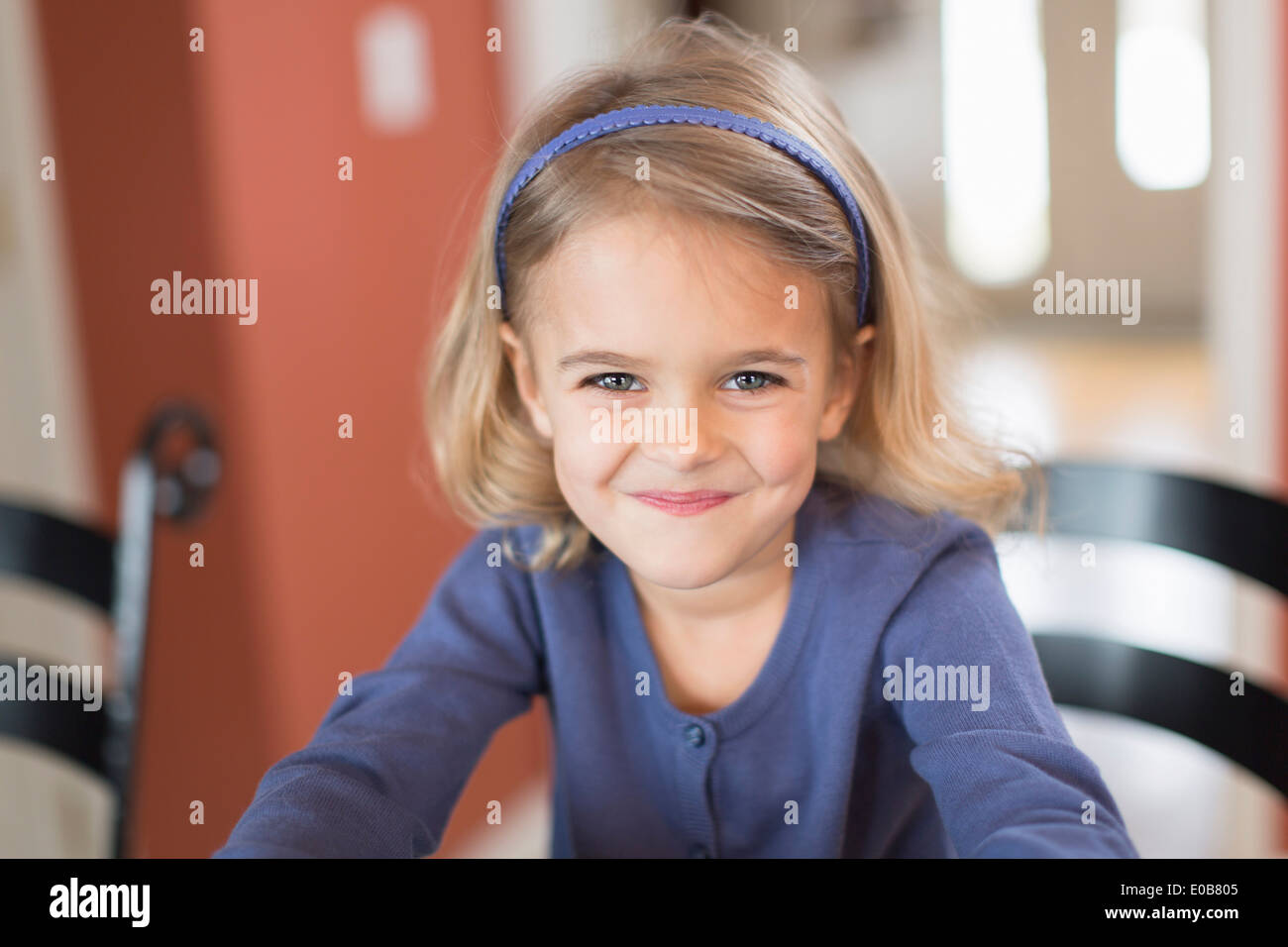 Portrait of smiling cute young girl - Stock Image