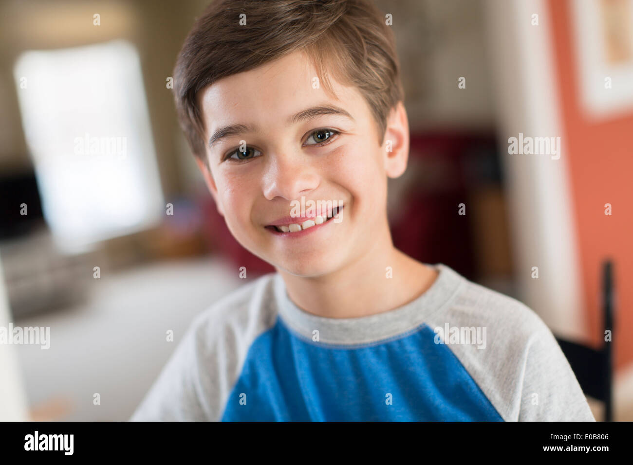 Portrait of smiling boy at home - Stock Image