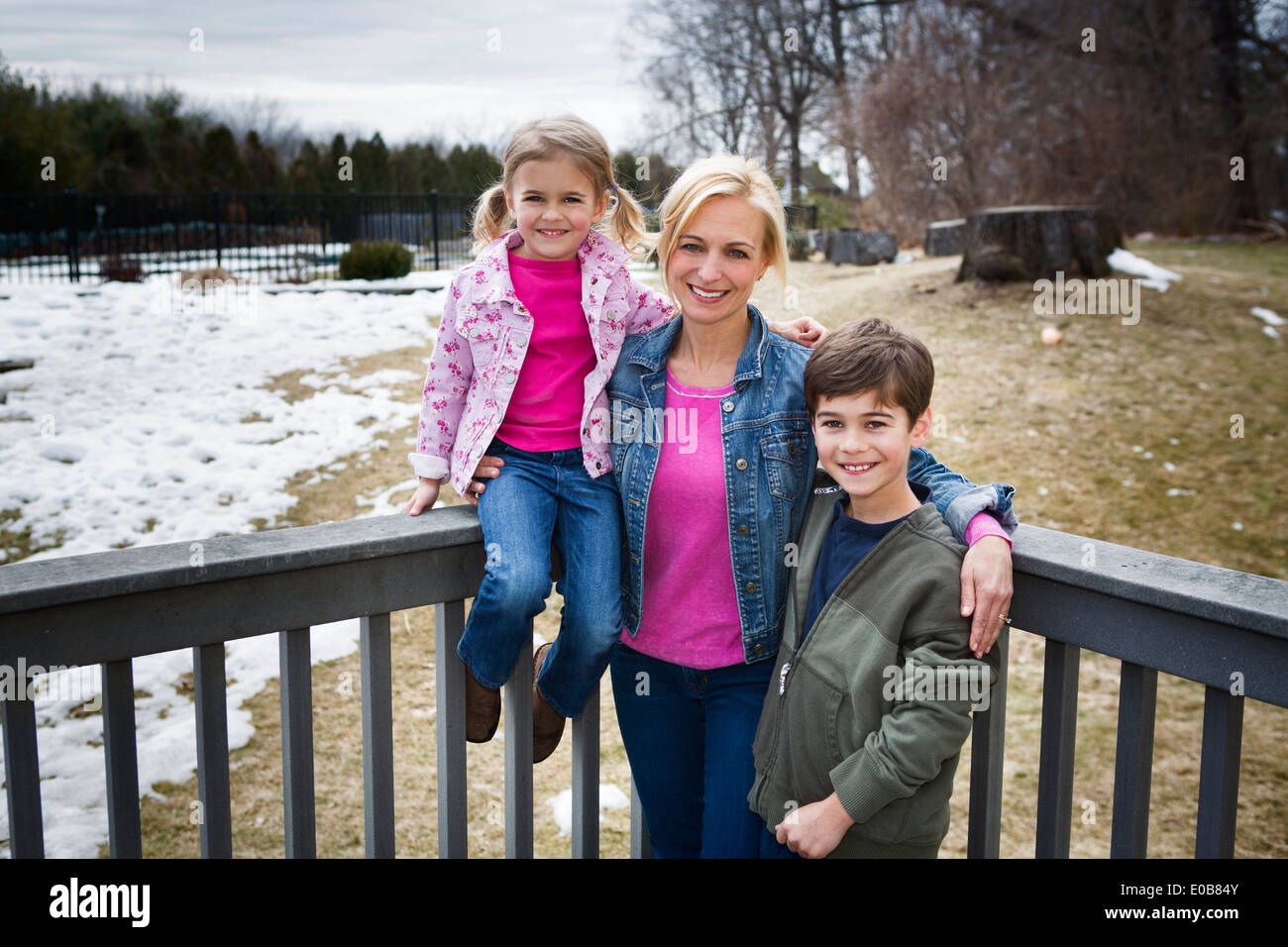 Portrait of mother and two children in park Stock Photo