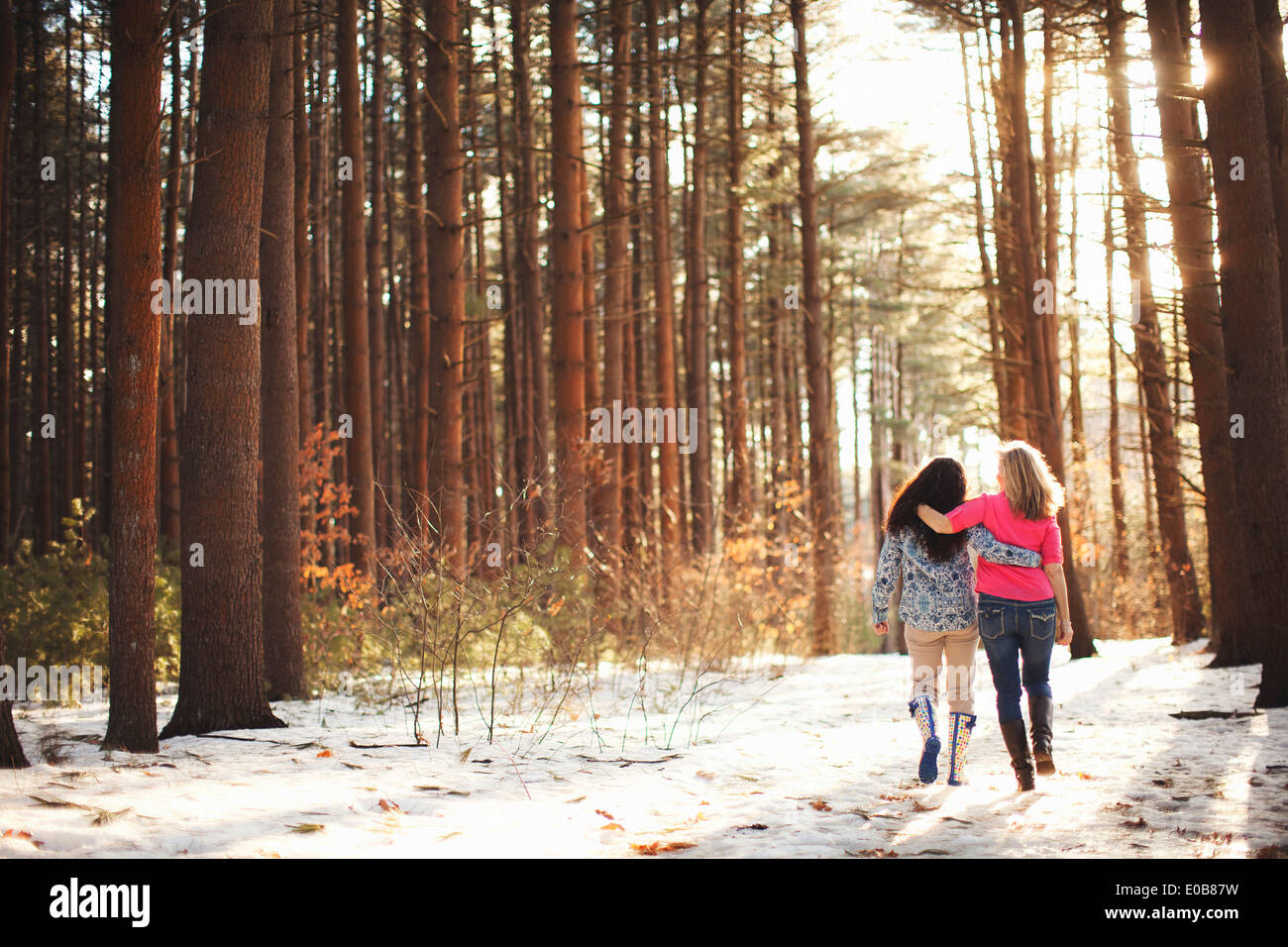 Mature women walking in forest - Stock Image