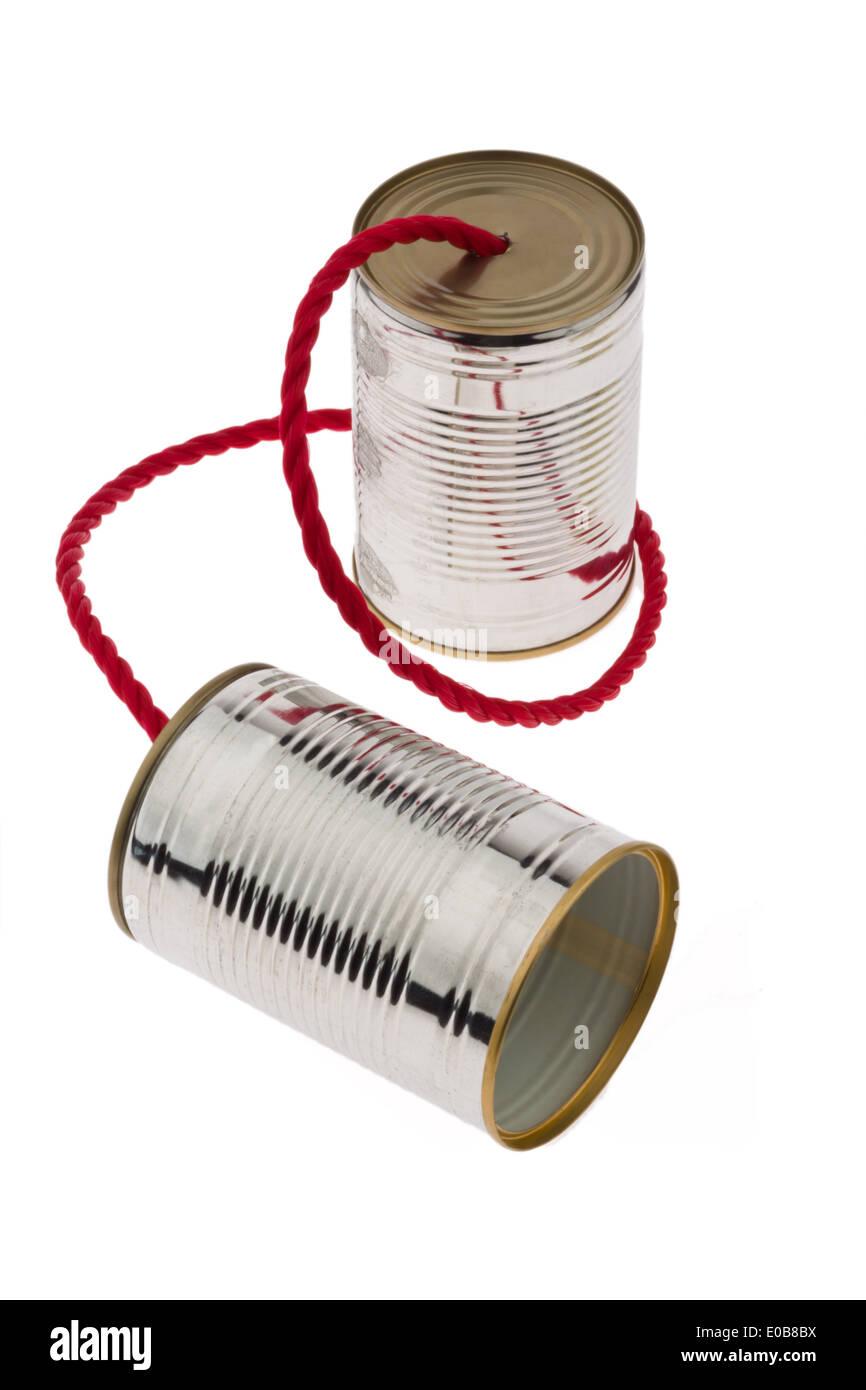 Two tins with string as a symbolic photo communication., Zwei Blechdosen mit Schnur als Symbolfoto Kommunikation. - Stock Image