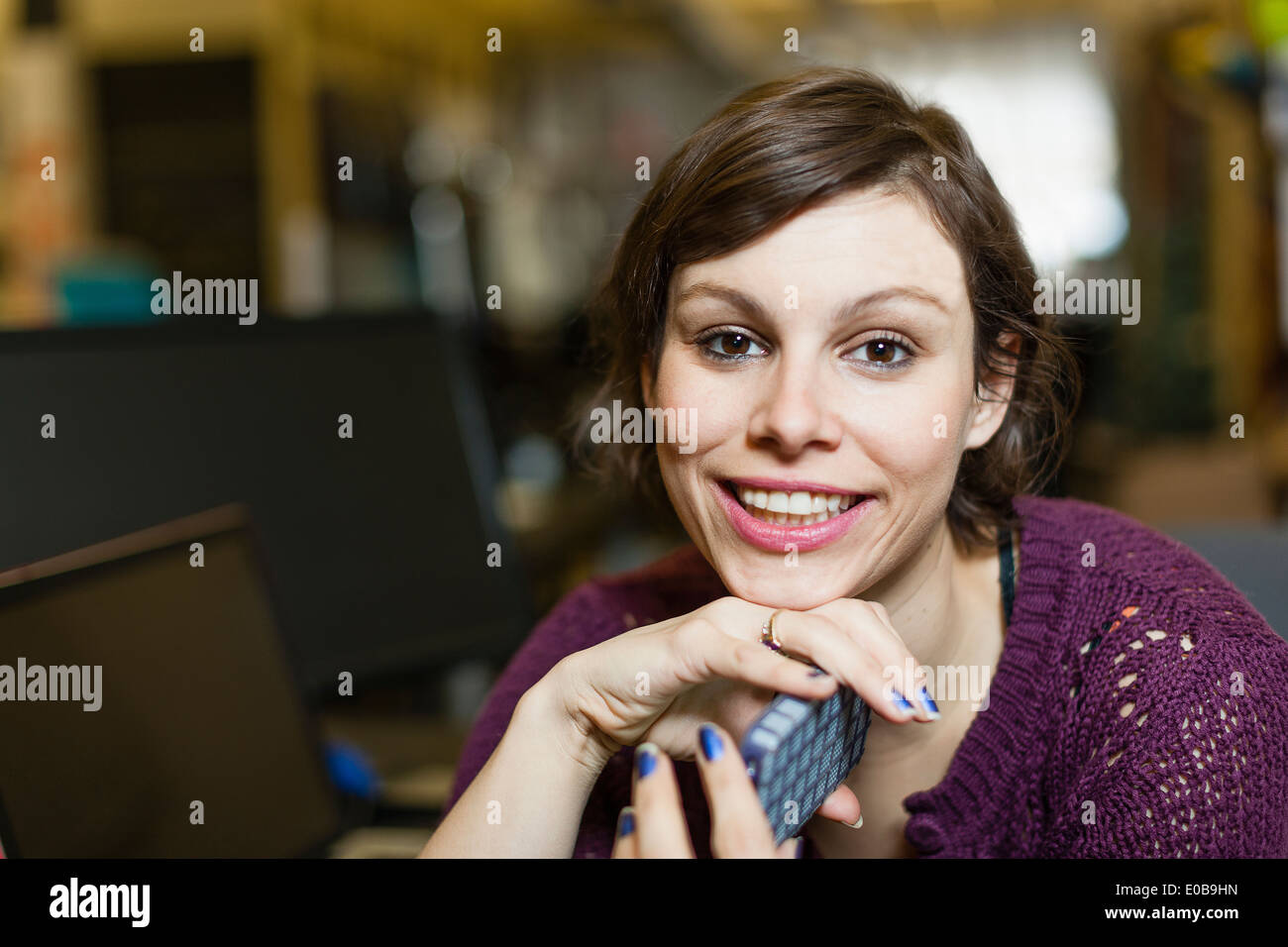 Portrait of female designer with smartphone Stock Photo
