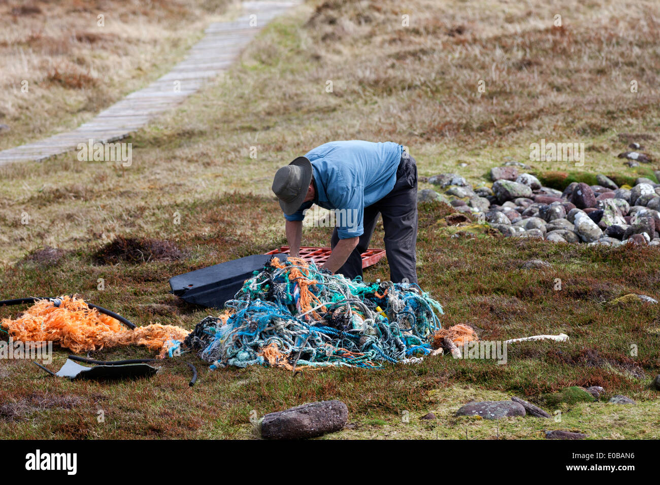 Scottish Wildlife Trust Member Clearing Plastic Debris Washed up on the Beach Handa Island Scotland UK - Stock Image