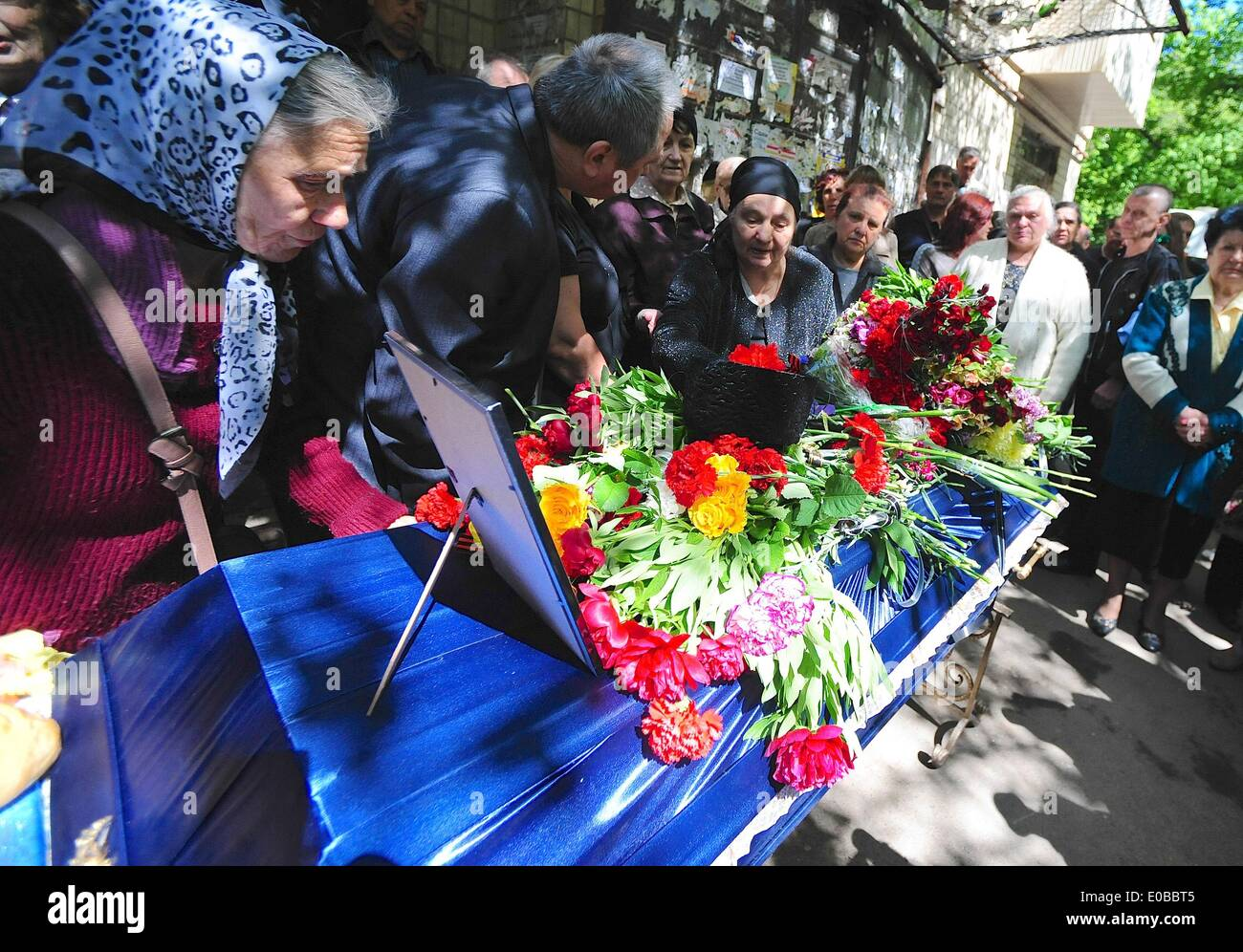 Odessa, Ukraine. 8th May, 2014. Family and friends gather for the funeral for Dmitry Nikityuk, 39, killed in the Odessa Trade Union buliding fire. He was buried in a closed coffin due to the severe disfigurement caused by the fire. Credit:  Gail Orenstein/ZUMAPRESS.com/Alamy Live News - Stock Image