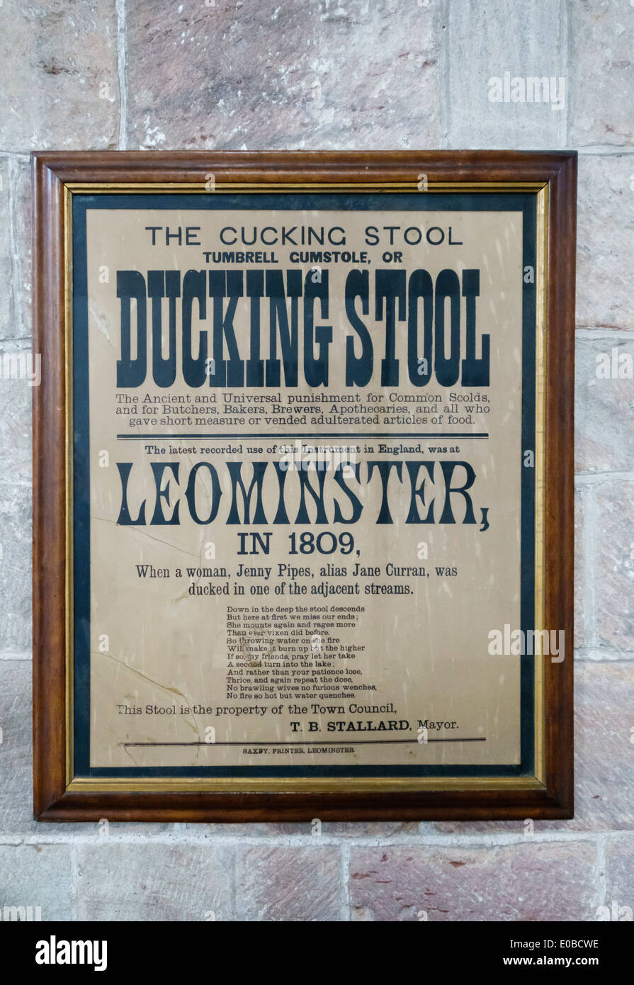 Herefordshire, UK. Sign in Leominster Priory Church describing the last public use of a ducking stool (or cucking stool) in England, in 1809 - Stock Image