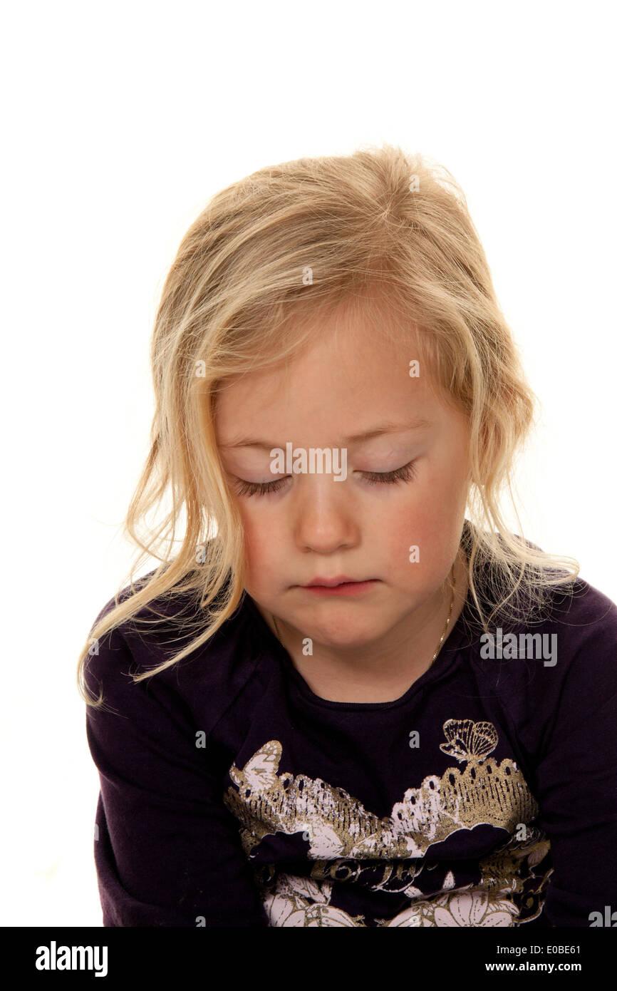 Portrait of a girl. Child head. Before white background, Portrait eines Maedchens. Kinderkopf. Vor weissem Hintergrund Stock Photo