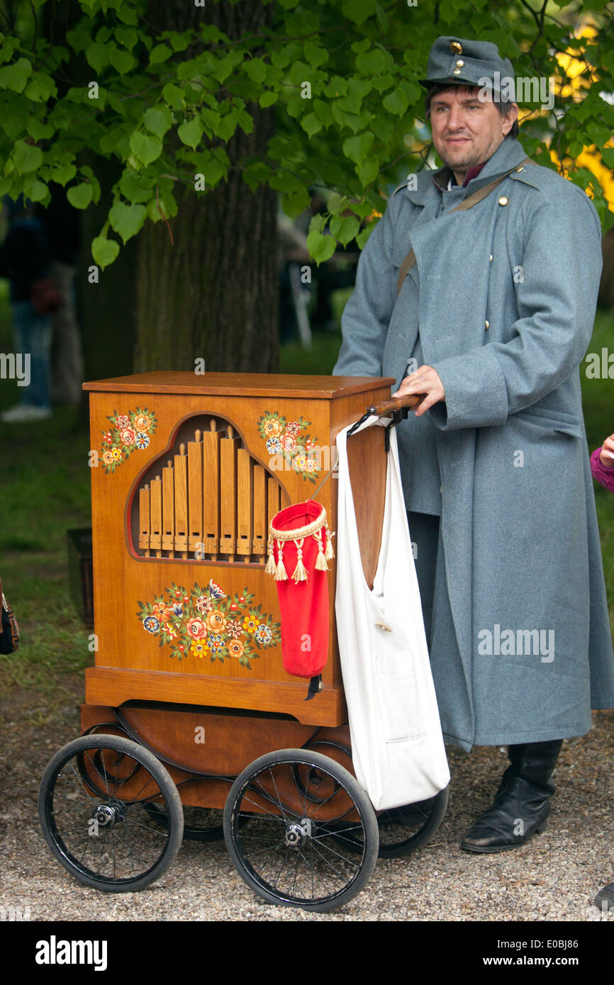 The soldier in the Austro-Hungarian uniform and barrel organ - Stock Image