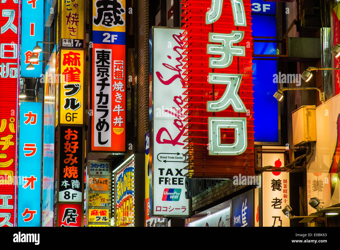 Colorful neon lights in Yasukuni-dori street, Shinjuku district, Tokyo, Japan - Stock Image
