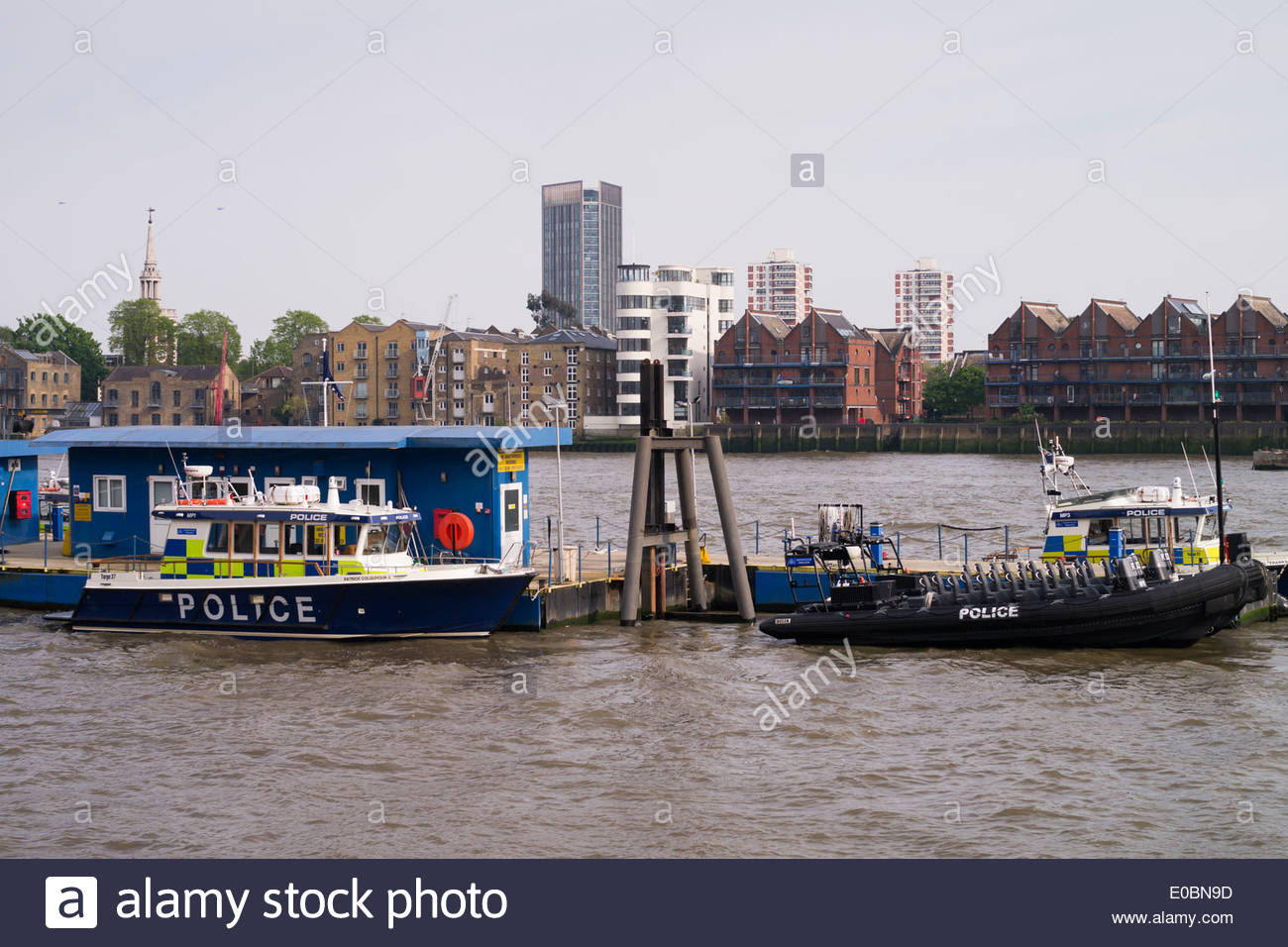 Marine Policing Unit pontoon on the River Thames at Wapping: London. - Stock Image