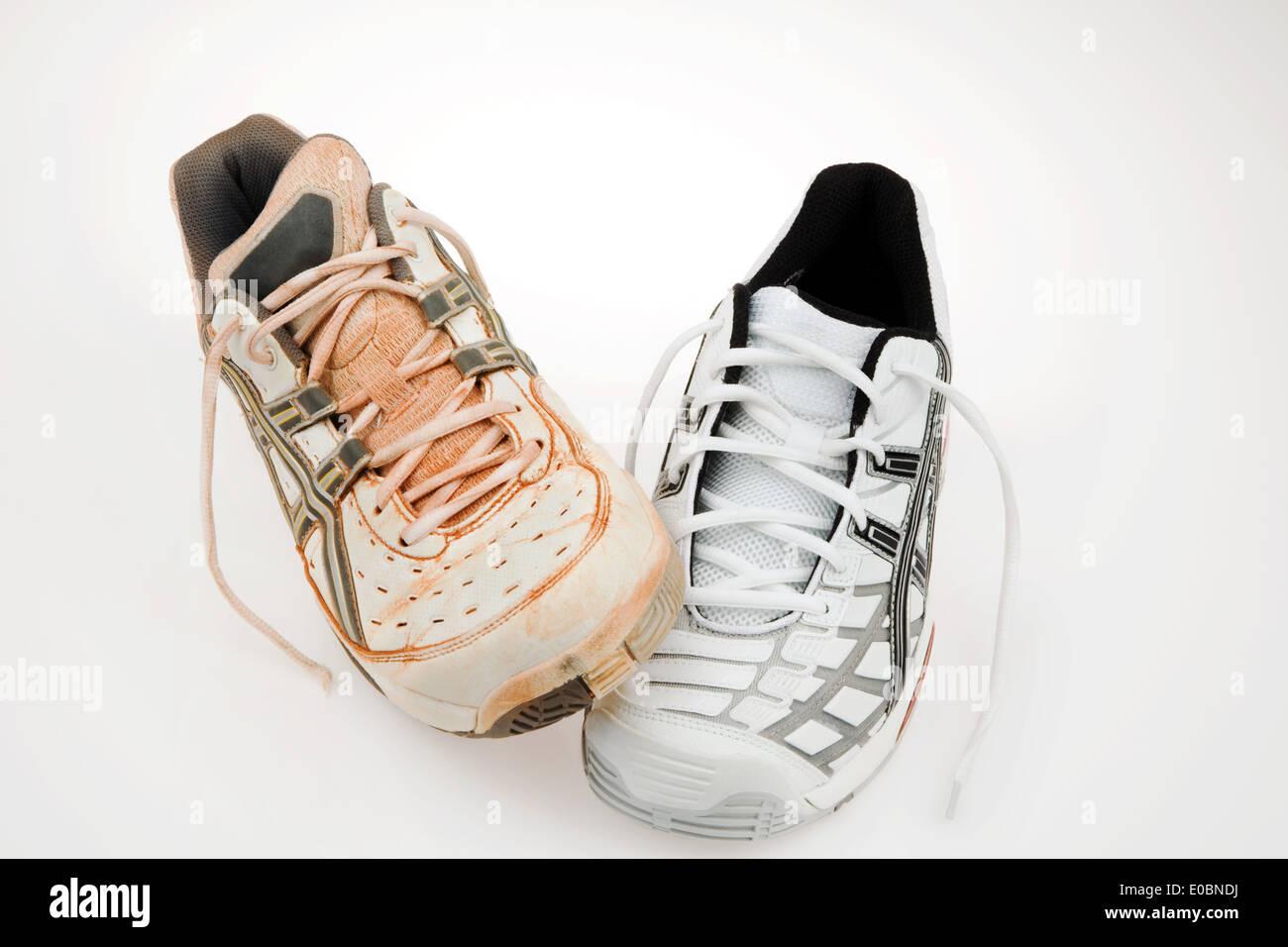 New sports shoes to the running and jogging on white background, Neue Sportschuhe zum Laufen und Joggen auf weissem Hintergrund - Stock Image