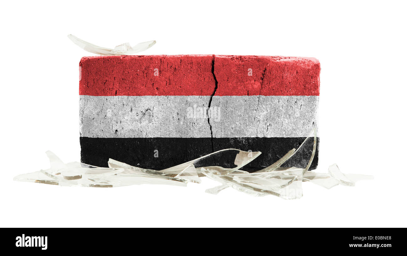 Brick with broken glass  violence concept  flag of Yemen - Stock Image