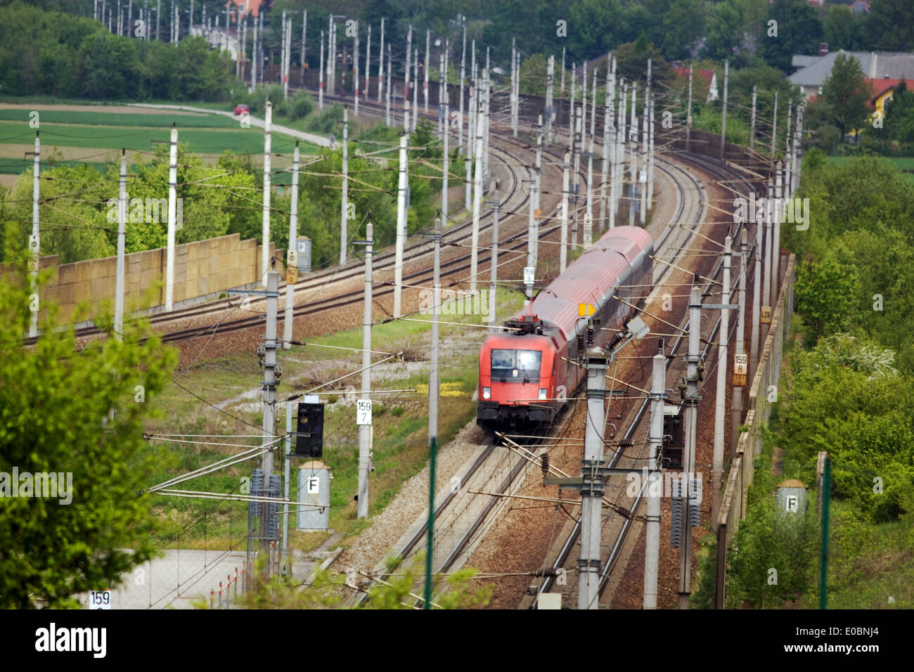 A train for people goes on railroad tracks, Ein Zug fuer Personen faehrt auf Eisenbahnschienen Stock Photo