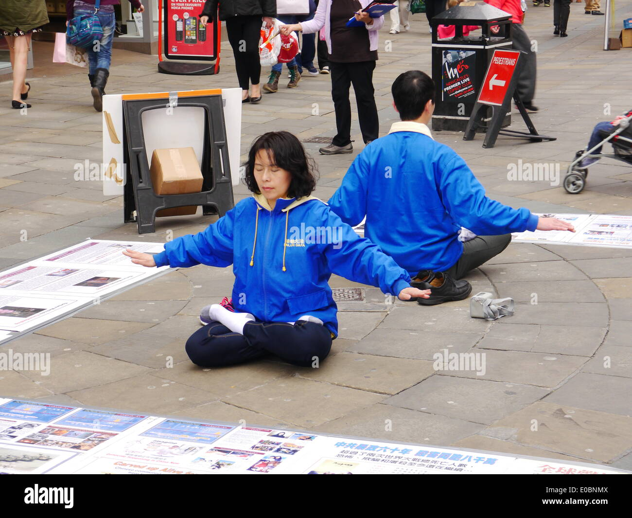 Newcastle upon Tyne, UK. 8th. May, 2014.  Supporters stage peaceful meditation protest against persecution of Falun Gong by the Chinese government. Credit:  Victor W. Adams/Alamy Live News - Stock Image