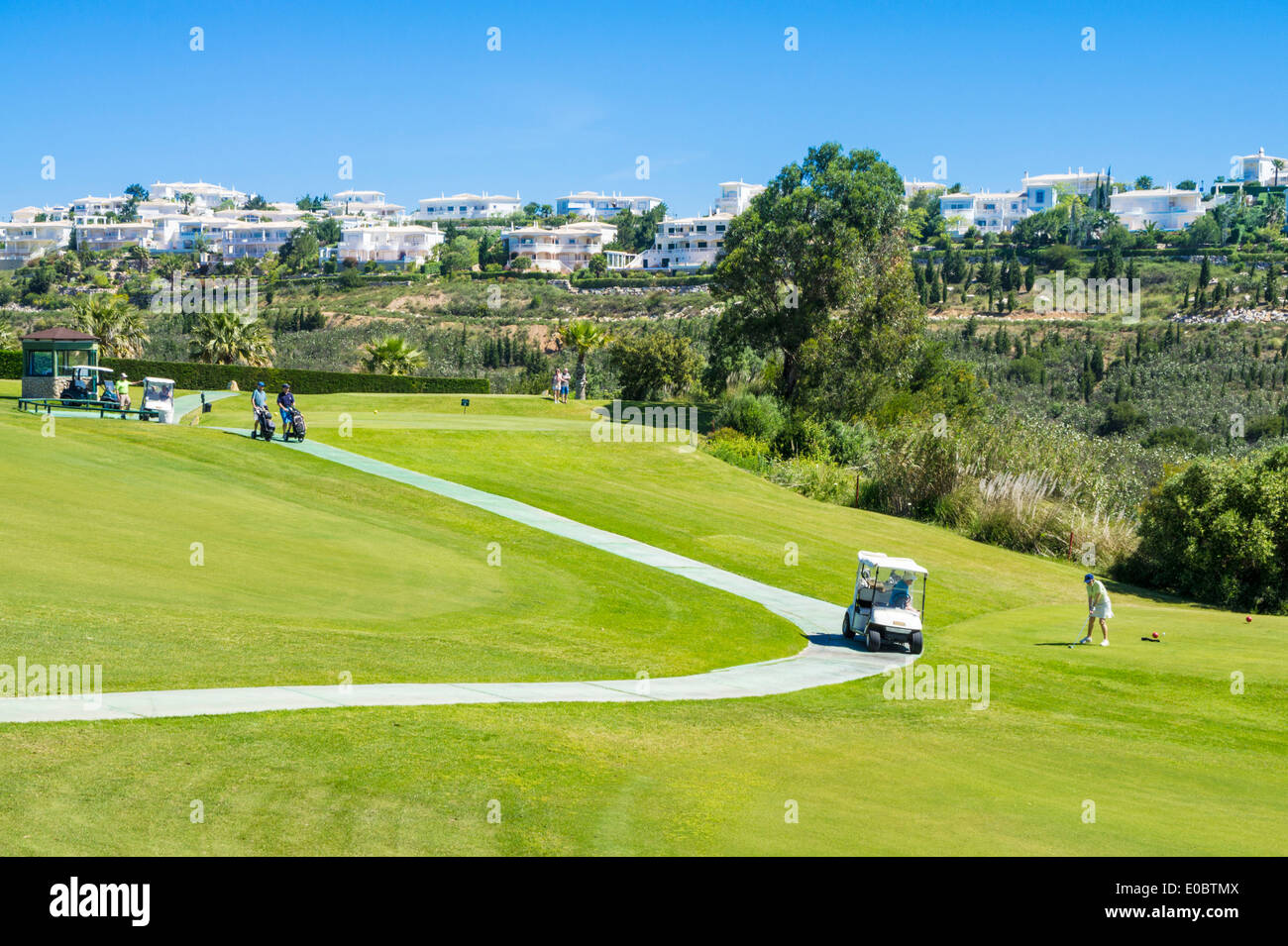 Golf buggy parked at the first tee Parque da Floresta golf course Vale do Poco Budens  near Salema Algarve Portugal - Stock Image
