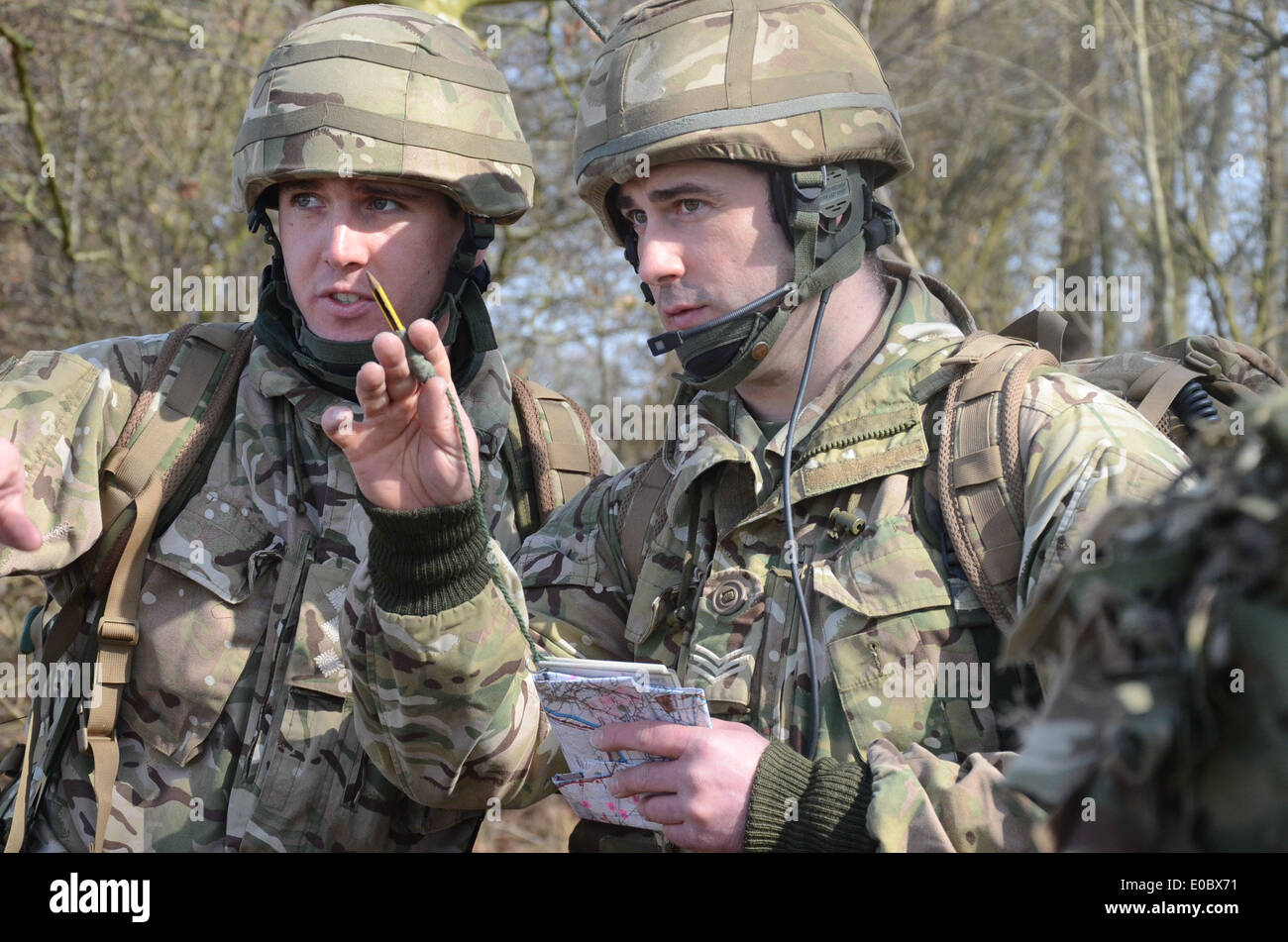 two british army soldiers plan a fire mission using bowman communication system Stock Photo