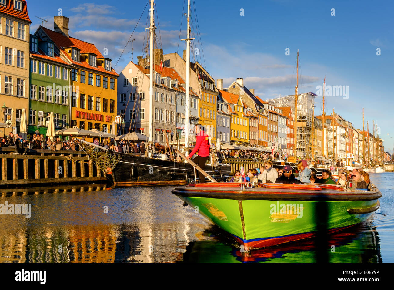 Excursion boat, Nyhavn canal, Copenhagen,  Denmark - Stock Image