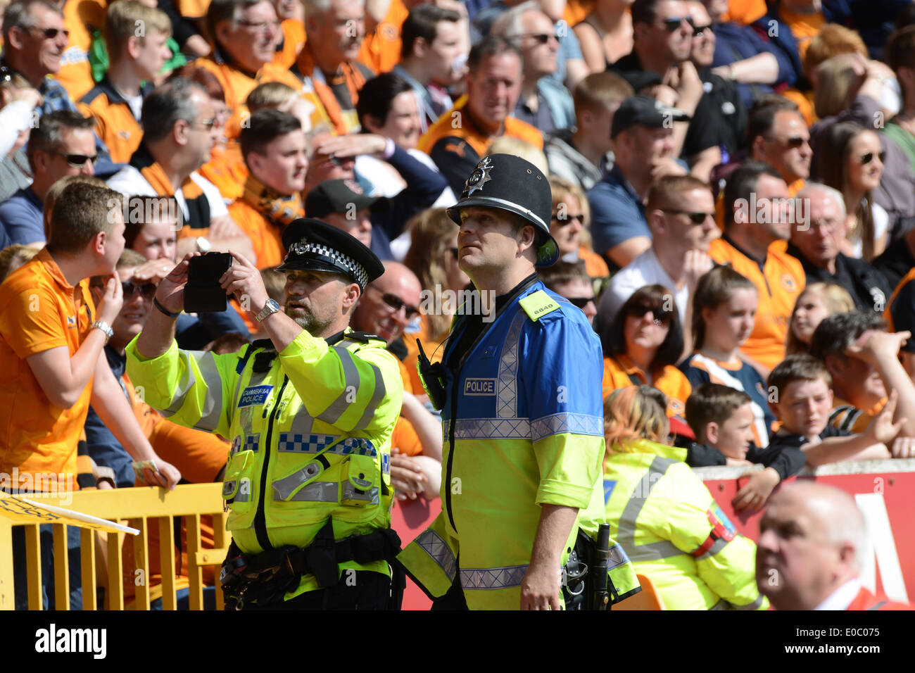 Police officer officers policing football match Uk - Stock Image