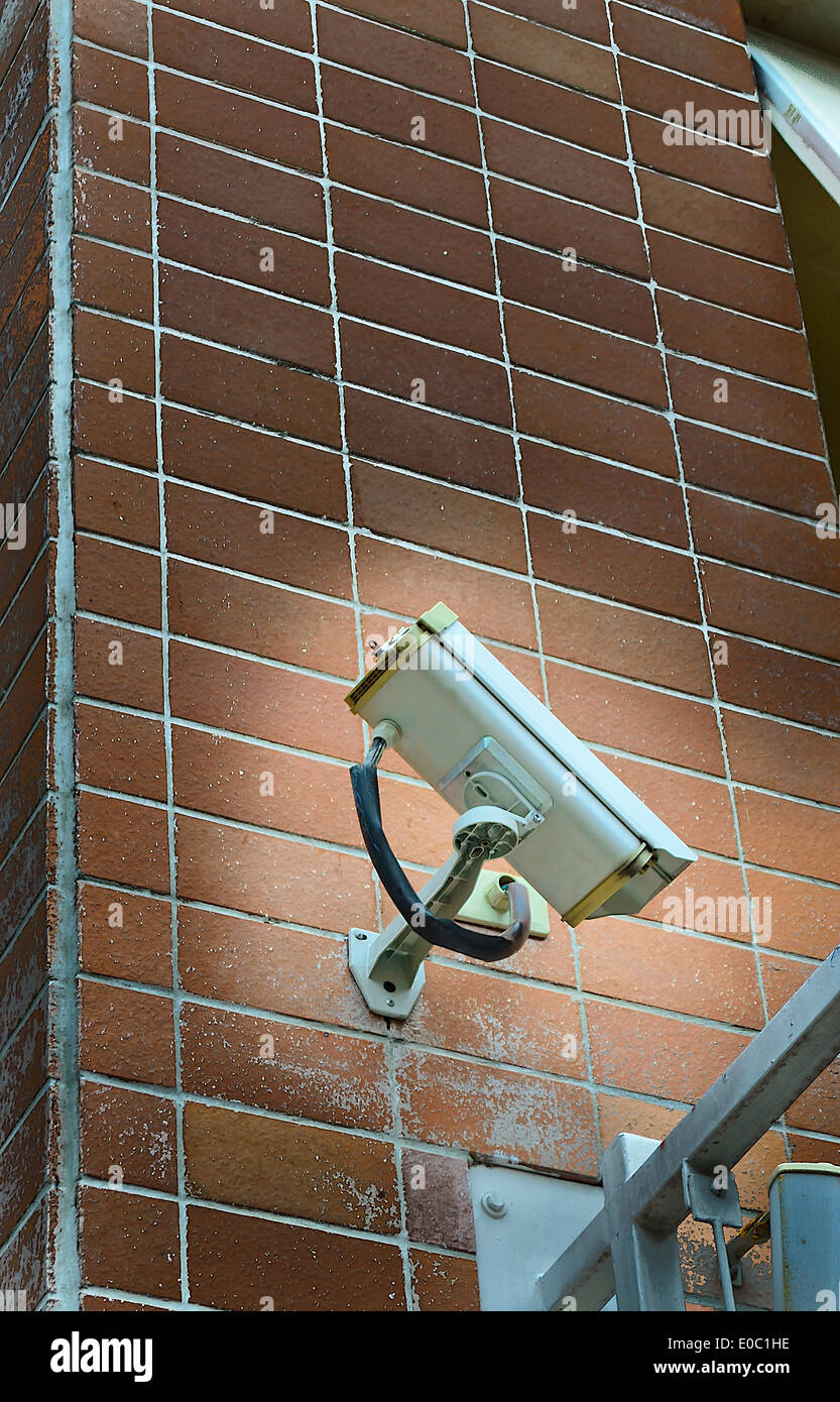 The CCTV camera secure monitor set on the wall to watch and record anything. - Stock Image