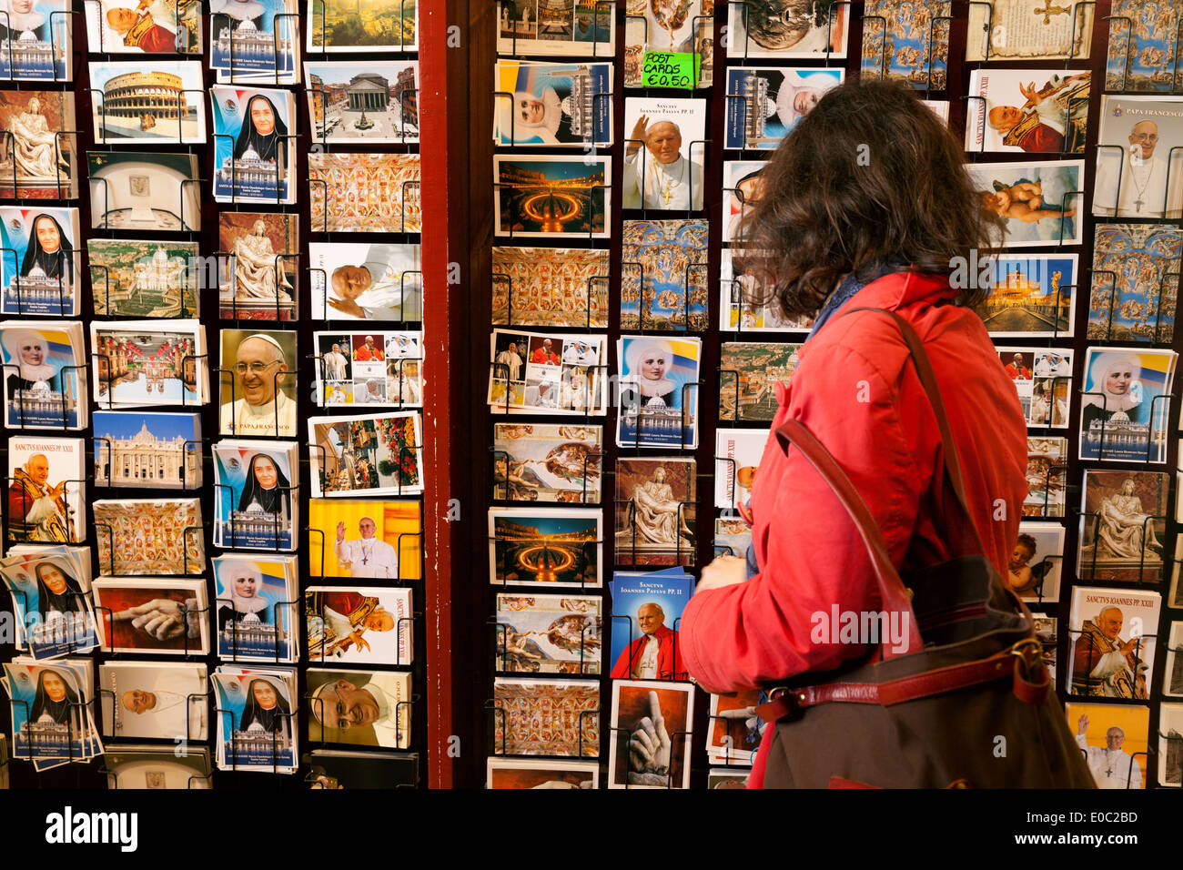 A woman tourist buying postcards, Rome, Italy, Europe - Stock Image