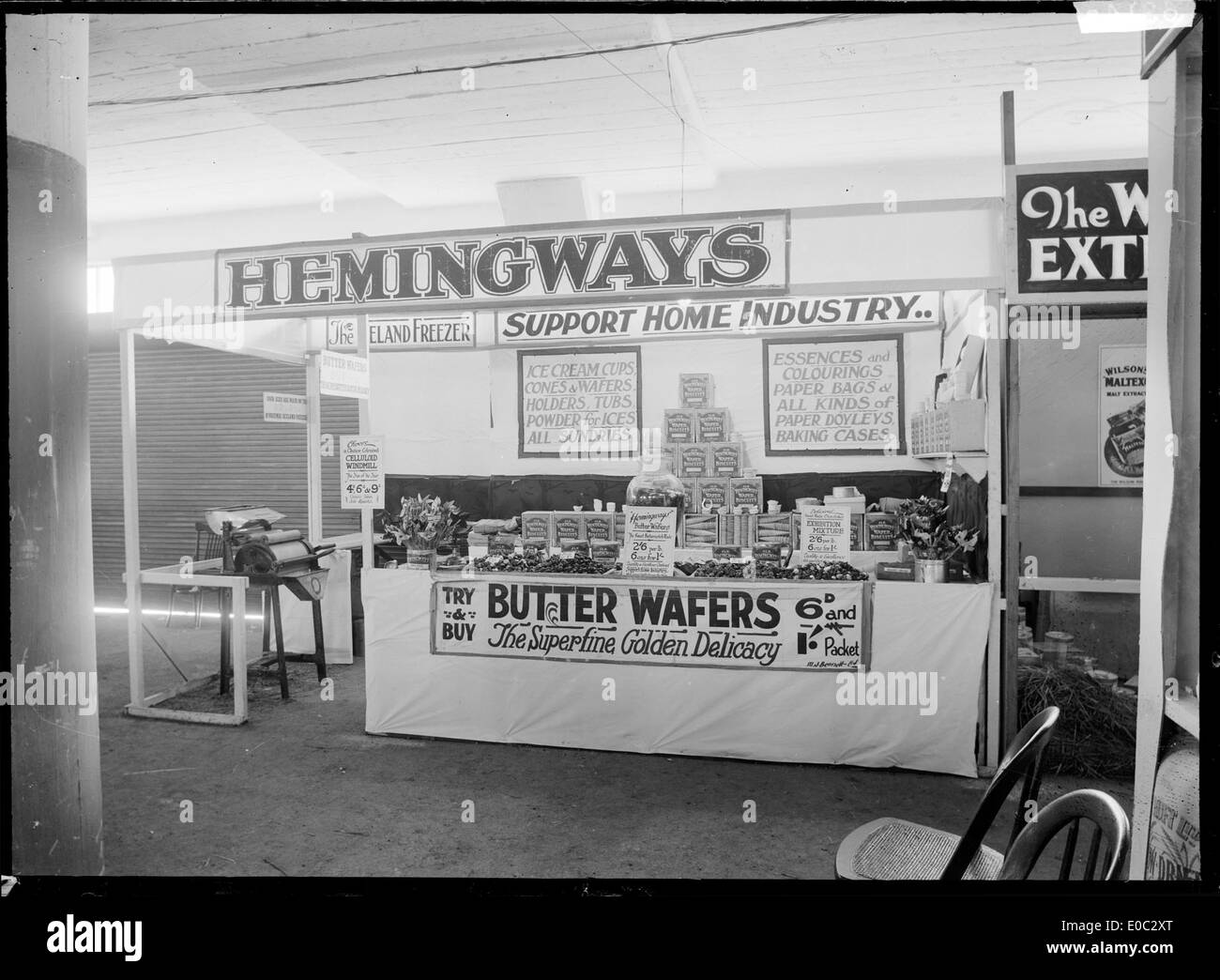 Stall at a trade fair advertising and displaying the produce of J L N Hemingway, including butter wafers and other items associated with ice creams, 1930 - Stock Image