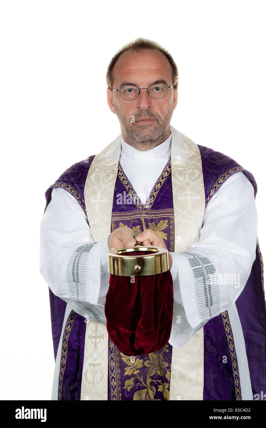 A Catholic priest collects money for the church, Ein katholischer Priester sammelt Geld fuer die Kirche - Stock Image