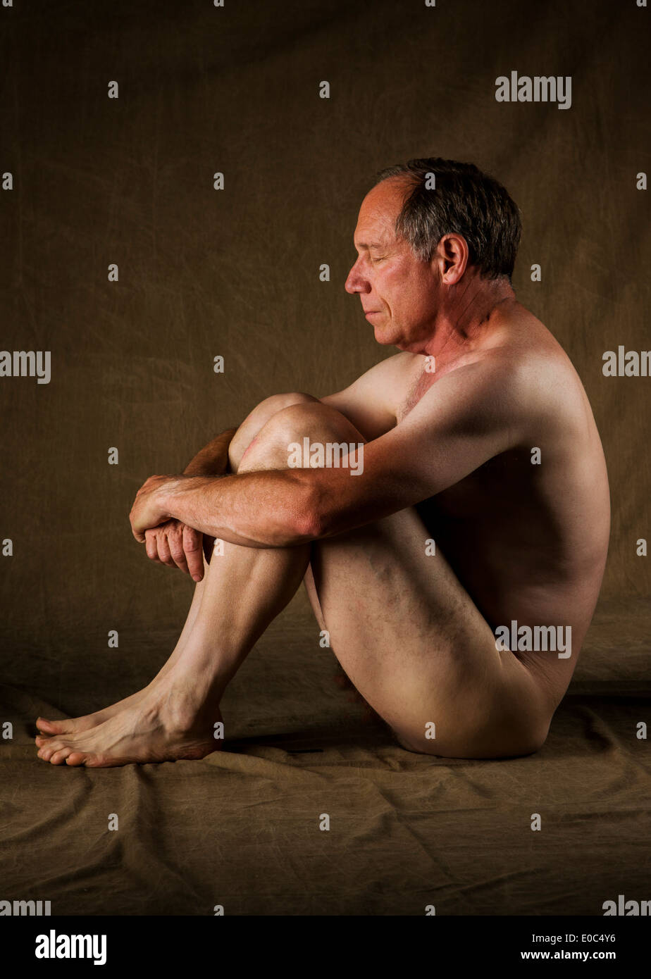 Nude Photographic Portrait Of Middle Aged Male In A Commercial Photography Studio