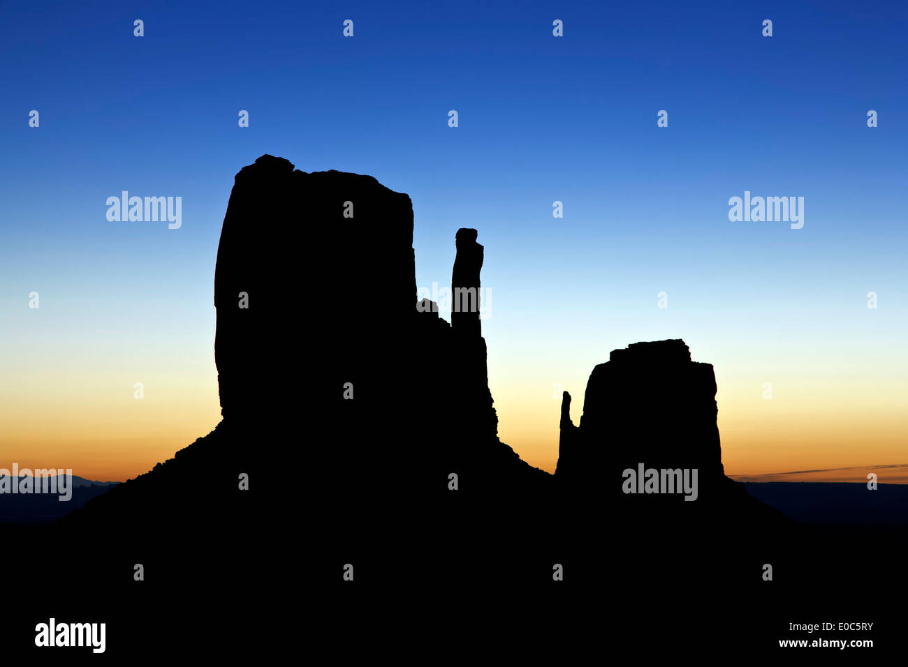 The Mittens silhouetted against morning sky, Monument Valley, Arizona Utah border USA - Stock Image