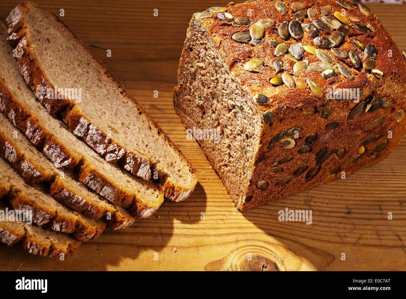 A fresh bread with pumpkin cores to the healthy food. Cakes and pastries of brown bread, Ein frisches Brot mit Kuerbiskernen Stock Photo