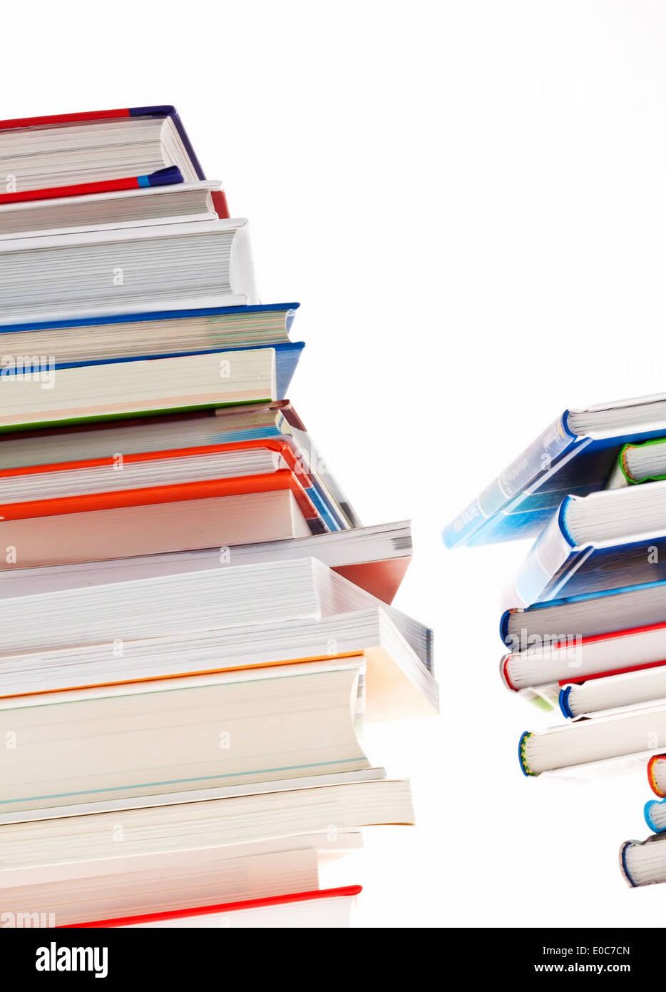 Pile of books. Released and isolates to orphan background, Stapel von Buechern. Freigestellt und isoliert verwaistem Hintergrund - Stock Image