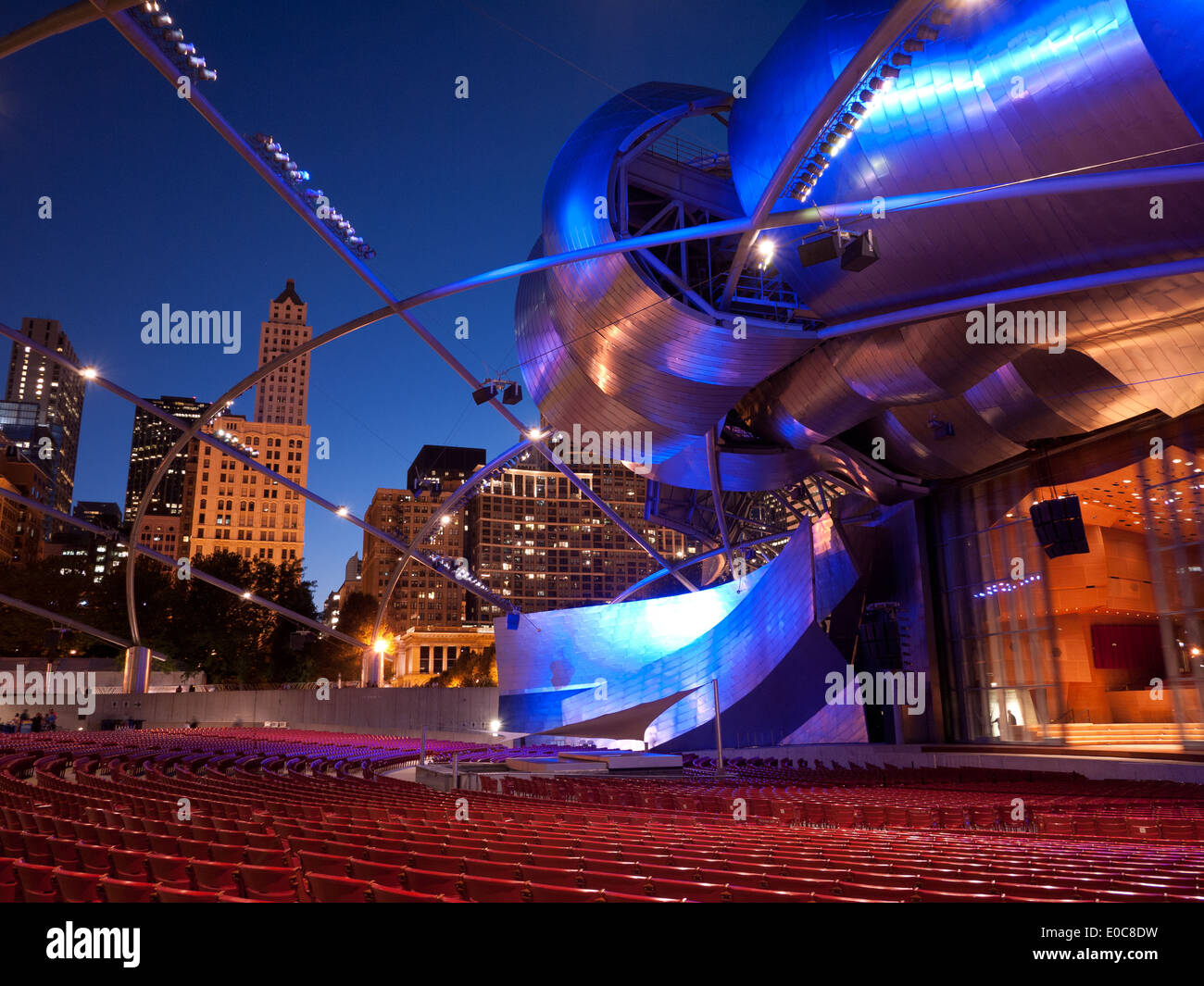 A view of the Jay Pritzker Pavilion, at night, in Millennium Park in Chicago, Illinois. - Stock Image