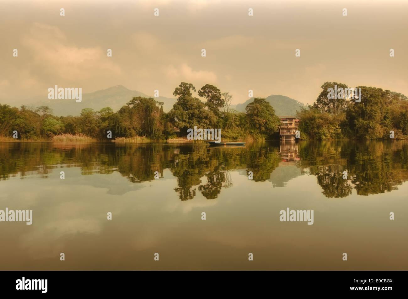 Pokhara lake sun rising reflection in rainy day in Nepal - Stock Image