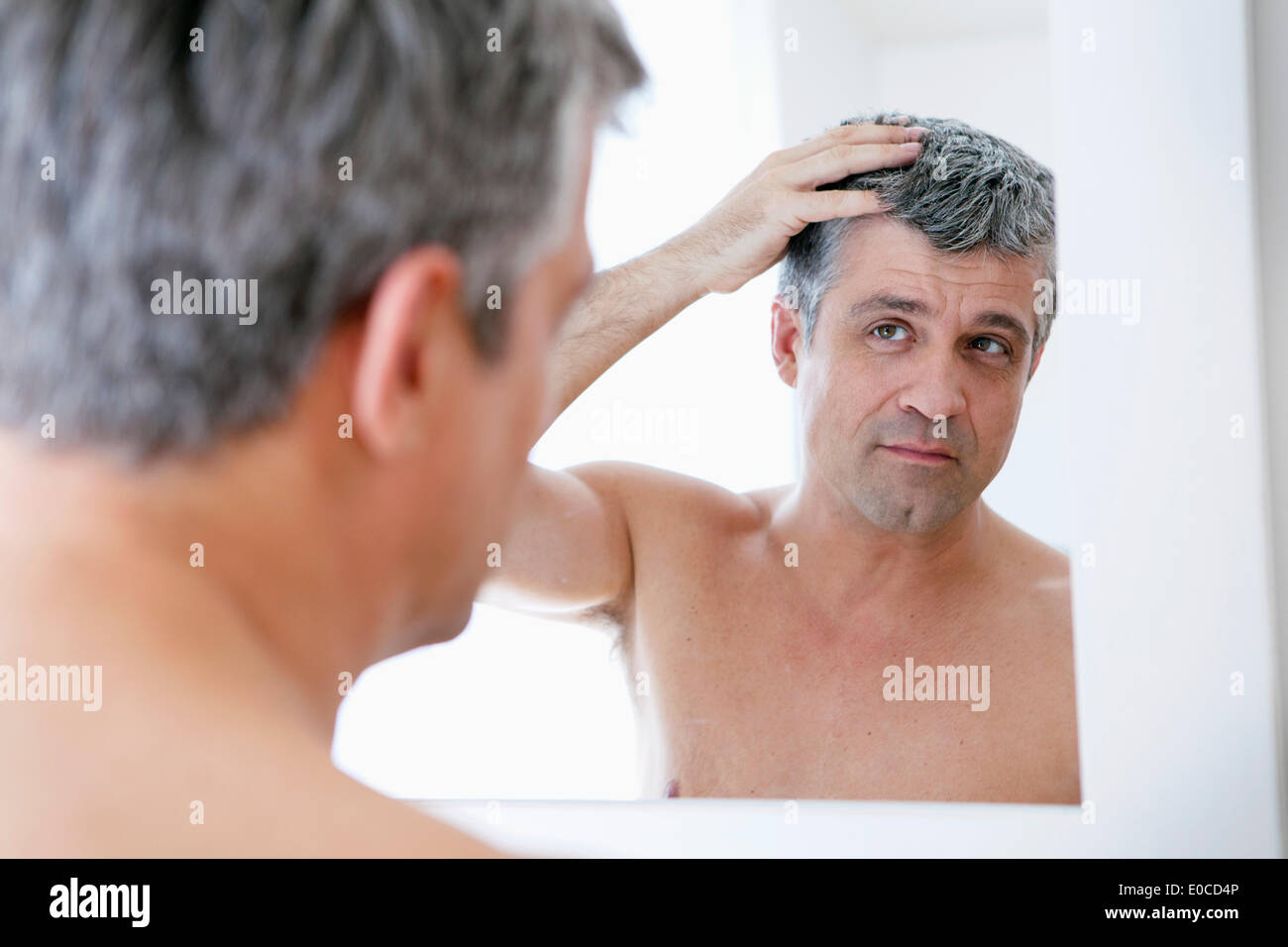 Man with mirror Stock Photo