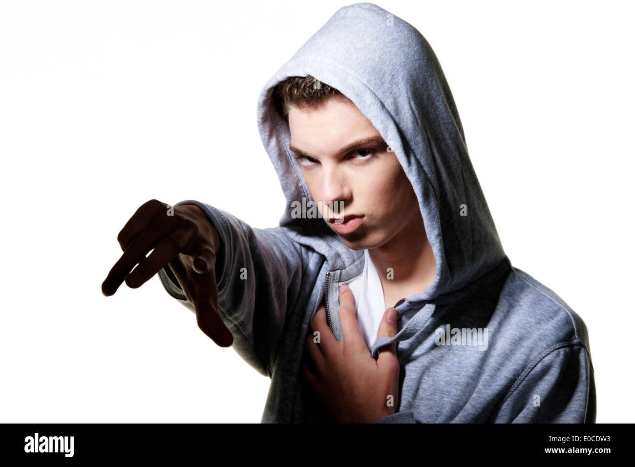 A cool looking youthful man with bonnet, Ein cool blickender Jugendlicher Mann mit Haube Stock Photo