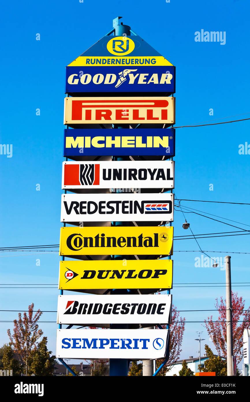 Advertising signs with enterprise of the tyre branch with a tyre trader, Werbeschilder mit Unternehmen der Reifenbranche bei ein - Stock Image