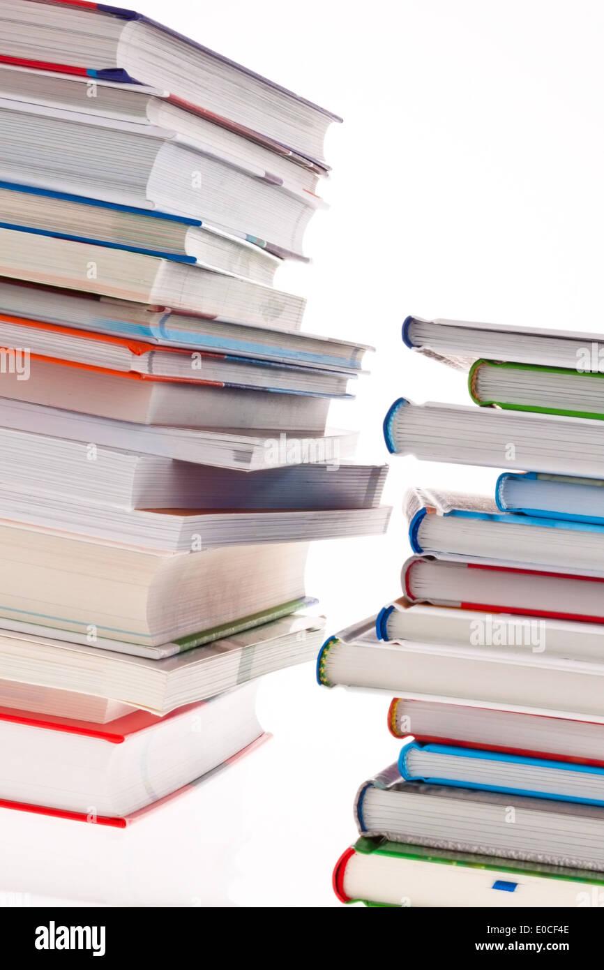 Pile of books. Released and isolates before white background, Stapel von Buechern. Freigestellt und isoliert vor weissem Hinterg - Stock Image